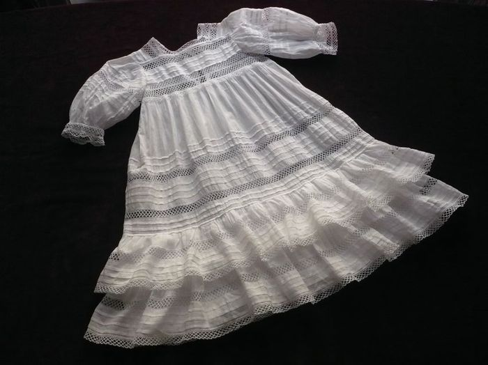 White linen child dress with lace