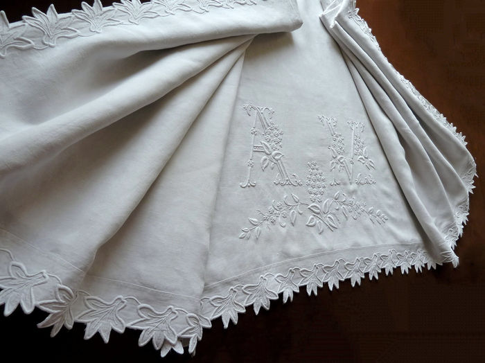 Antique quality embroidered linen sheet monogrammed AM.