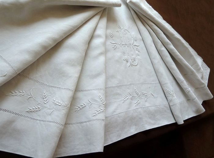 antique linen sheet monogram HB embroidered with wheat ears.